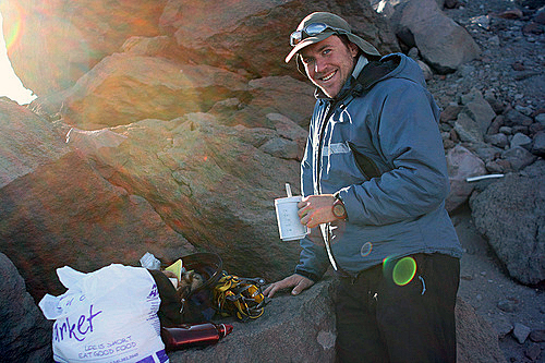 Mt Hood. Oregon. USA. Ben making evening meal at our top camp before summit attempt later that night