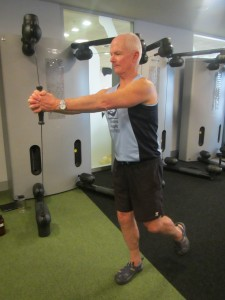 The strange knee pounding exercise of holding a sideways resistance against a Kinesis machine while standing on one leg