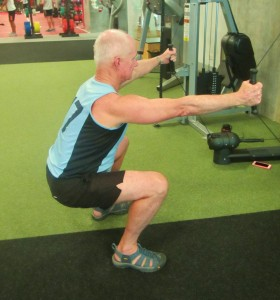 Squats on a Kinesis machine on the last day of gym rehab. Arms are pulled towards your side coming up out of the squat
