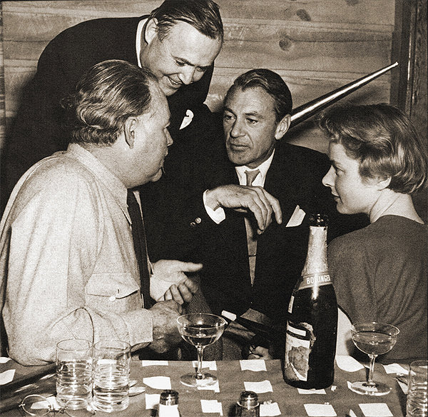 Hemingway (l) enjoying the company of Gary Cooper (centre) . The woman on the right is, I think, a very young Ingrid Bergman